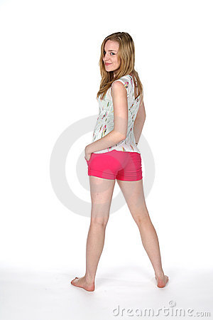 Pretty woman in tight pink shorts with bare feet