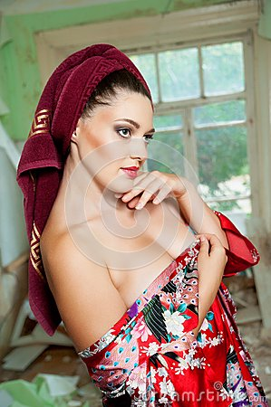 Pretty woman with a towel