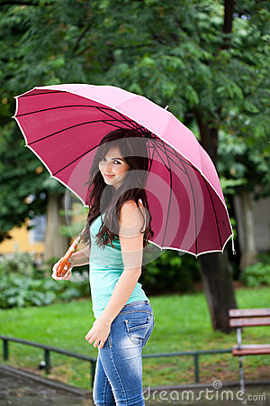 Pretty Woman Under Big Umbrella In The Park