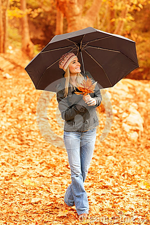 Pretty woman under umbrella