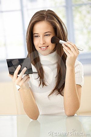 Pretty woman using makeup