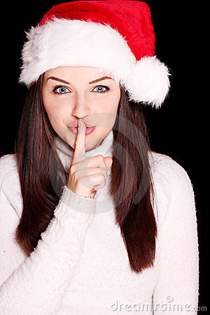 Free Pretty Woman Wearing Santa Hat Saying Shh Stock Photo - 11750830