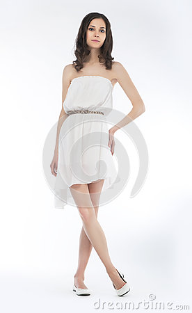 Pretty woman in white dress isolated - studio shot