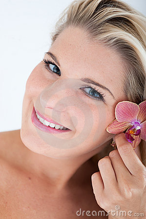 Pretty woman whith pure healthy skin and orchid