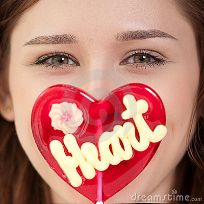 Free Pretty Woman With Candy Heart Royalty Free Stock Image - 22966806