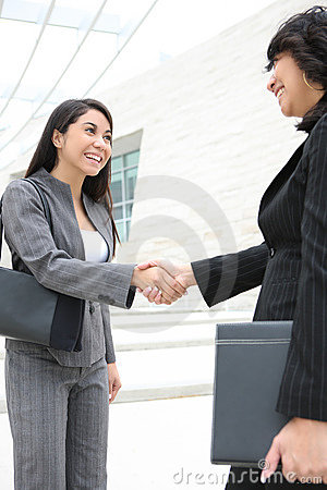 Pretty Women at Office Building Shaking Hands