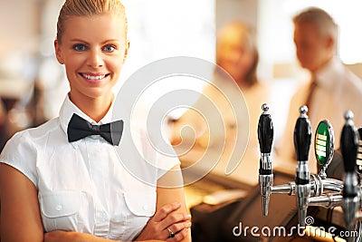 Pretty young barmaid at work