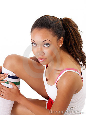 Pretty young black woman sitting exercise clothes