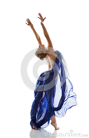 Pretty young blonde dancing with blue cloth