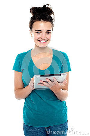 Pretty young brunette using wireless tablet device