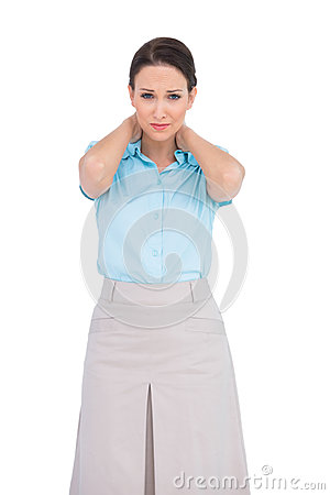 Pretty young businesswoman suffering from painful neck
