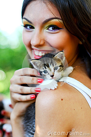 Pretty young caucasian girl with kitten