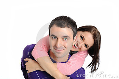 Pretty young couple in love embracing. isolated