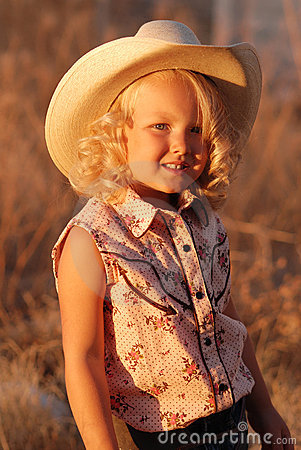 Free Pretty Young Cowgirl. Royalty Free Stock Photography - 5775397