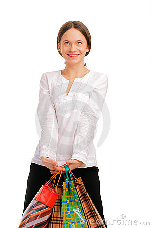 Pretty young female holding her shopping bags