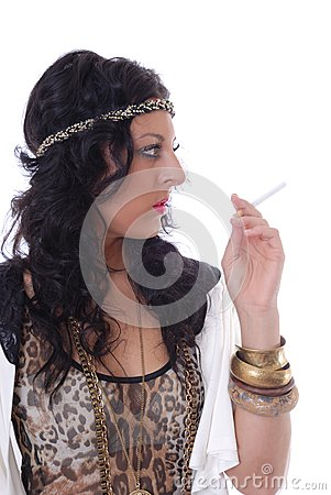 Pretty young female isolated with cigarette