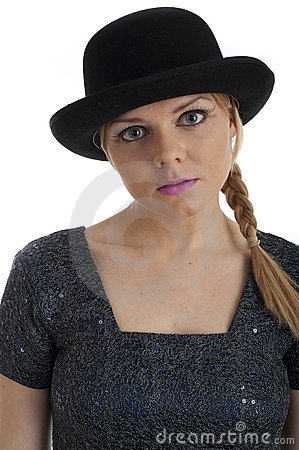 Pretty young female in retro 60s style and bowler