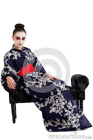 Pretty young Geisha girl relaxing