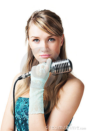 Pretty young girl holding retro microphone