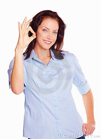 Pretty young girl showing the OK sign over white