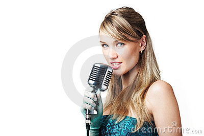Pretty young girl singing into retro microphone