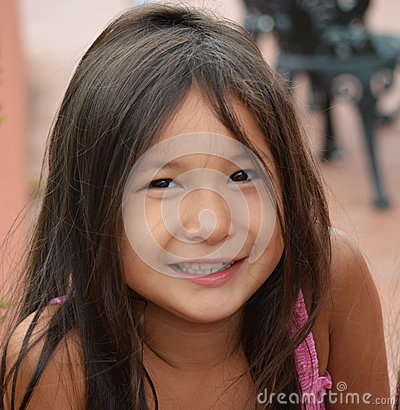 pretty young girl smiling outside