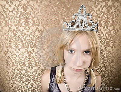 Pretty young girl with a tiara pouting