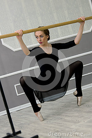 Free Pretty Young Graceful Ballet Dancer Warms Up In Ballet Class Stock Photos - 82951183