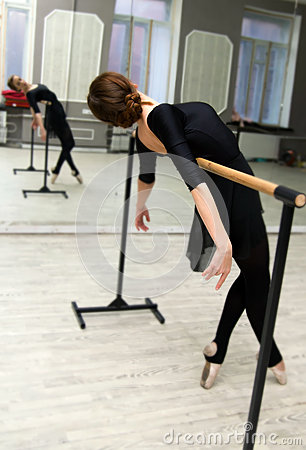 Free Pretty Young Graceful Ballet Dancer Warms Up In Ballet Class Royalty Free Stock Image - 82953186