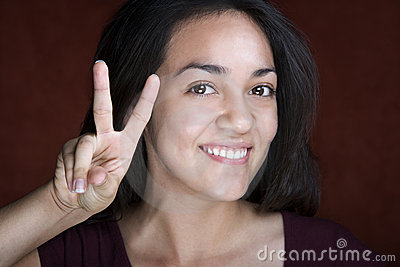 Pretty Young Hispanic Woman Making Peace Sign