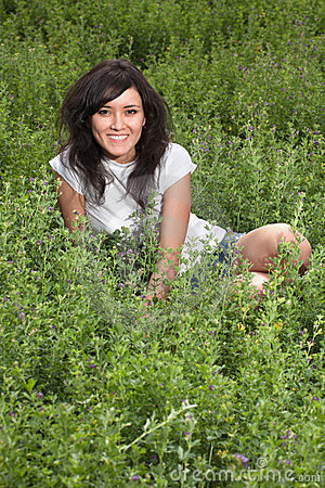 Pretty young lady on a meadow