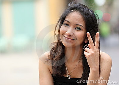 Pretty young smiling asian woman