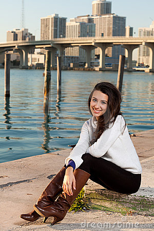 Free Pretty Young Woman Along The Bay With Skyline Royalty Free Stock Photos - 17461788
