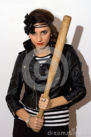 Pretty young woman with a bat