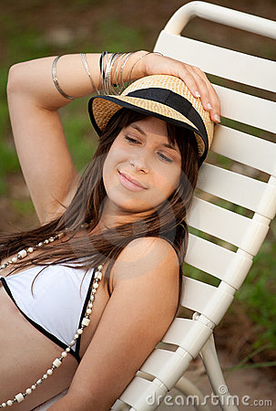 Pretty Young Woman in Bathing Suit and Hat