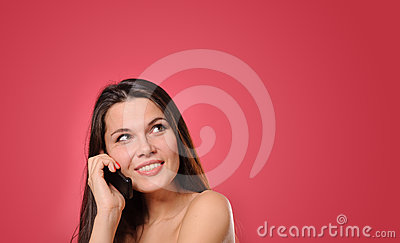 Pretty young woman calling by phone