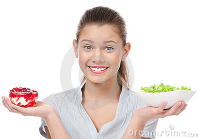Pretty young woman choice salad or cake. Isolated