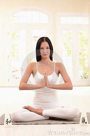 Pretty young woman doing yoga meditation