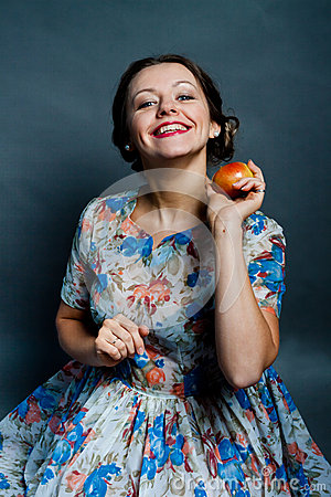 Pretty young woman dropping an apple