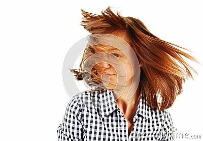 Pretty young woman flinging long hair into air