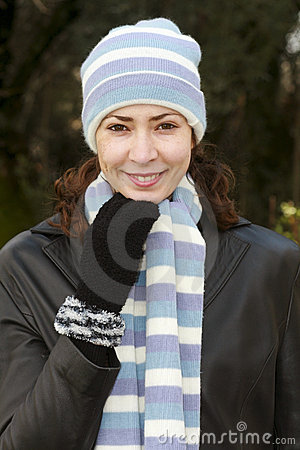 Pretty young woman in hat & scarf.