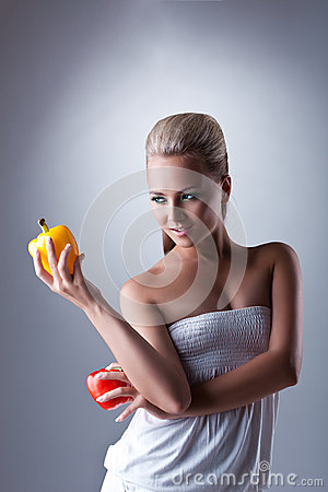 Pretty young woman hold two bulgarian pepper