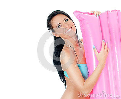 Pretty young woman holding pink inflatable mattress.