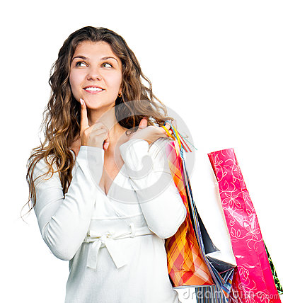 Pretty young woman holding shopping bags