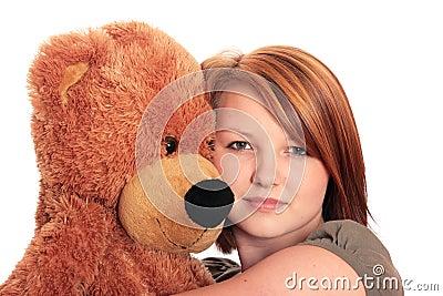 Pretty young woman hugging a Teddy Bear