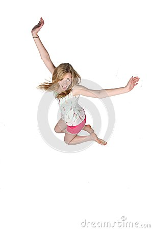 Pretty young woman jumping for joy and fun