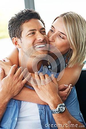 Pretty young woman kissing her boyfriend