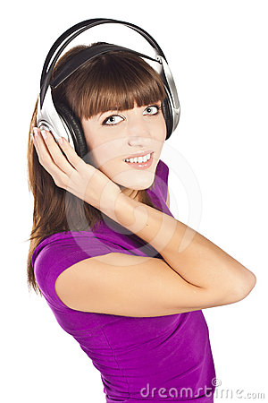 Pretty young woman listening music