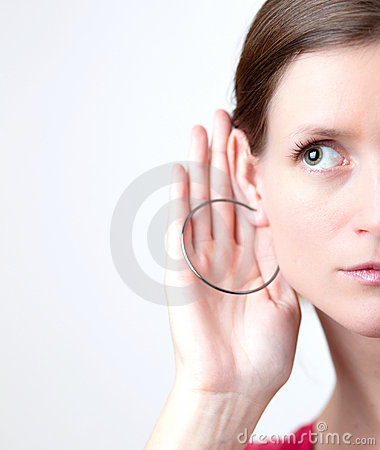 Pretty young woman listens attentiv
