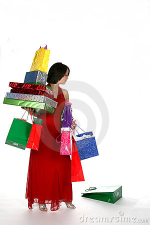 Pretty young woman loaded down with gift bags